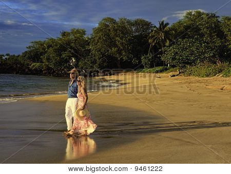 couple walking on a maui beach