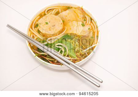Bun bo or Vietnamese vermicelli noodles with beef on a white background