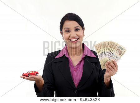 Cheerful Business Woman With Money And Toy Car