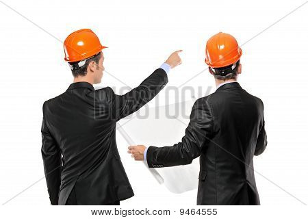 A View Of A Foremen In A Suit Looking