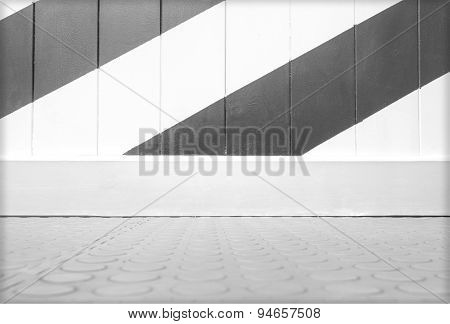 Empty panel wall colored diagonally and tile floor