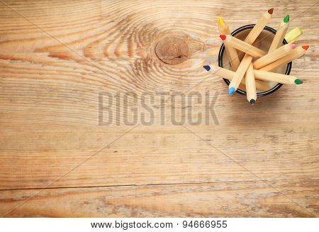 Pencils In A Mug On A Wooden Table