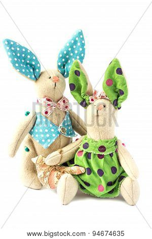 Two toy bunny in love . Isolate.