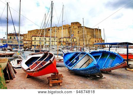 Castel dell'Ovo and old boats. Naples, Italy