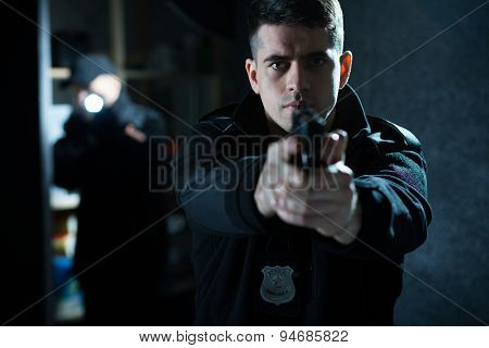Policeman Holding A Handgun