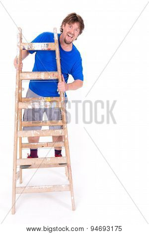Smiling Man Standing On A Ladder