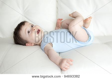 baby boy relaxing in sofa at home