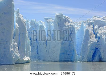 Blue Ice Columns On The Water