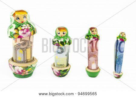 Russian Babushka  Dolls With Euro Bills Isolated
