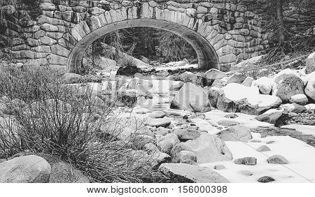 river covered with snow at Sequoia national park, USA in black and white