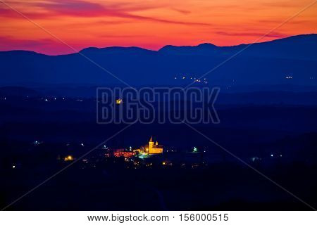 Blue landscape at red sundown in Prigorje region of Croatia Dropkovec village