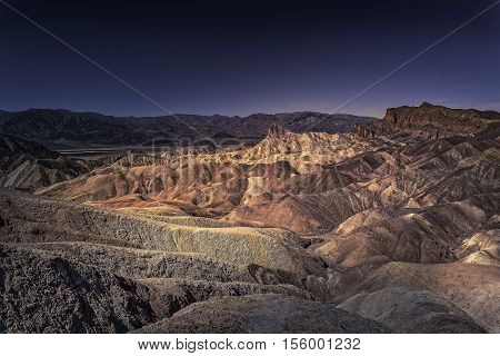View of Death Valley California at sunset from Zabriskie Point