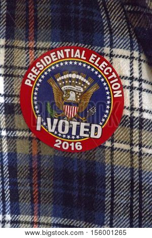 Close up of a 2016 North Carolina election sticker with a symbol of the American eagle and flag saying