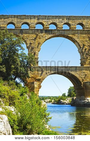 Roman aqueduct Pont du Gard Unesco World Heritage site. Located near Nimes Languedoc France Europe.
