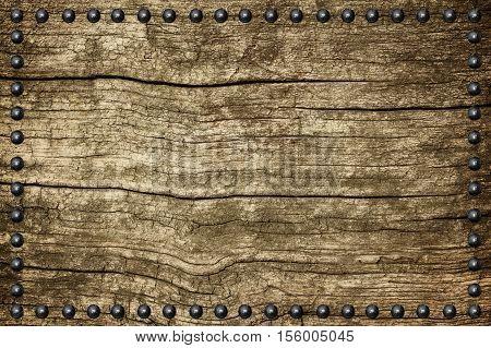 Dark grunge seamless wood plate texture with rivet.
