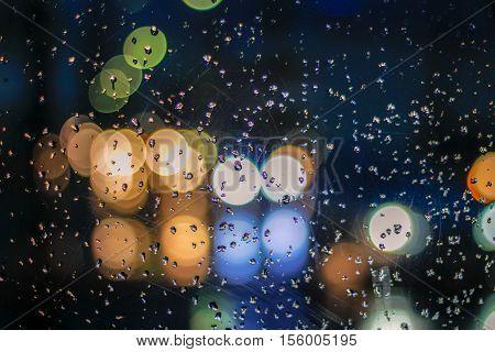 Traffic Scene From A Wet Cristal Window