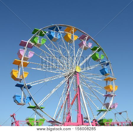Colorful ferris wheel awaits customers seen looking up