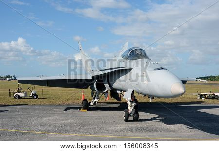 Modern navy jetfighter parked on the ground between