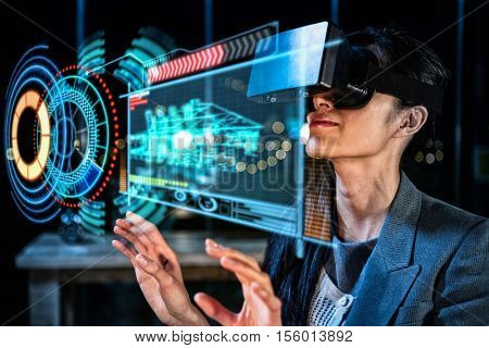 Digitally generated image of volume dial with digital interface against businesswoman using virtual reality headset