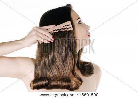 Woman with shiny brown hair on white