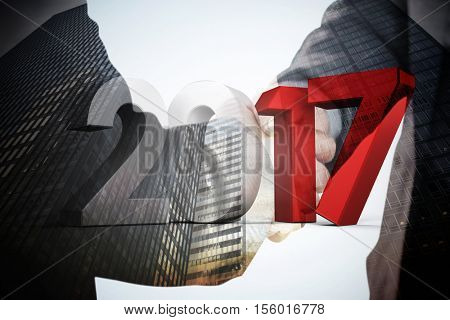 Composite image of gray and red numbers against composite image of business people shaking hands close up