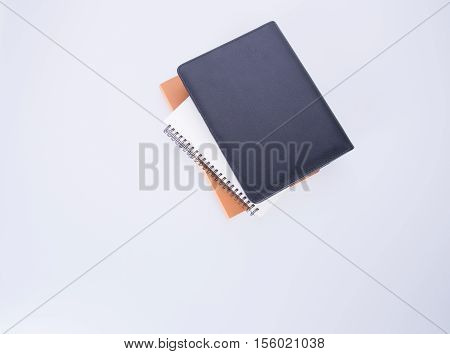 Notebook Or Black Leather Notebook On The Blackground.