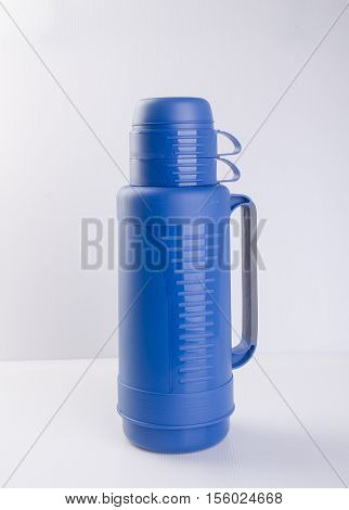Thermos Or Plastic Thermos Flask On A Background.