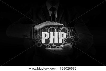 technology and internet concept - businessman holds the php button on virtual screens.