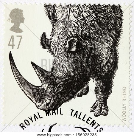 LUGA RUSSIA - NOVEMBER 6 2016: A stamp printed by GREAT BRITAIN shows Woolly Rhino - Ice Age Animal circa 2006