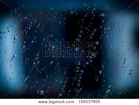Water Droplets On Window At Dark Autumnal Rainy Day