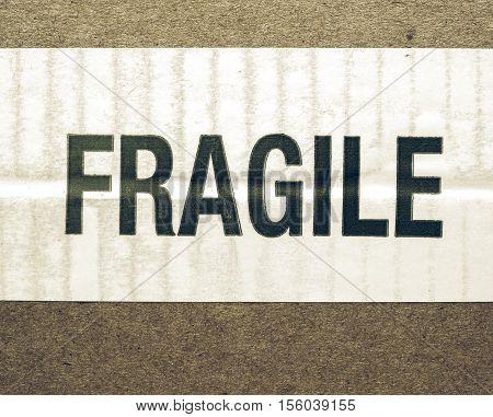 Vintage looking Detail of a fragile corrugated cardboard packet poster