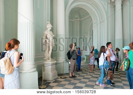 TSARSKOYE SELO, SAINT - PETERSBURG, RUSSIA - JULY 25, 2016: People look at the sculptures in the The Grotto Pavilion. The project of the pavilion was drawn up by the architect Rastrelli