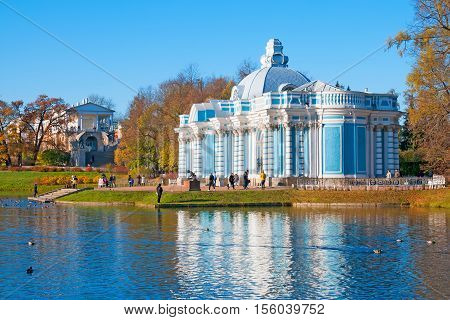 TSARSKOYE SELO, SAINT - PETERSBURG, RUSSIA - OCTOBER 19, 2016: People near The Grotto Pavilion next to The Great Pond in the Catherine Park. The Tsarskoye Selo is State Museum-Preserve