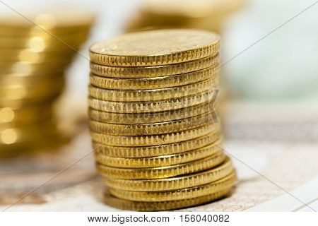 photograph taken close-up, which shows the Polish coin lying on the paper money. Zloty, a small depth of field poster