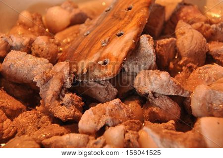 Afelia. Cypriot national dish of marinated and stewed pork in aromatic spices.