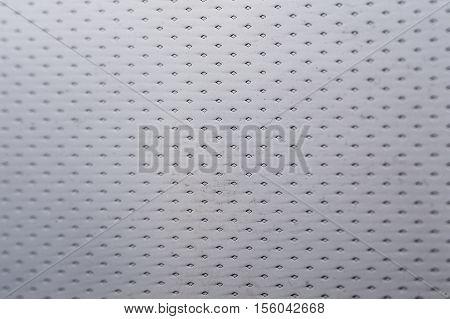 Glossy grey metal texture background macro shot