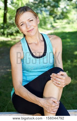 Woman With Sports Injury Sustained Whilst Exercising Outdoors