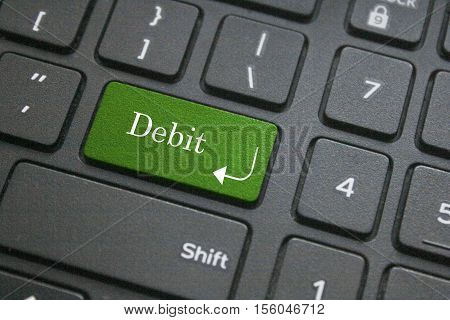Close up of debit word on computer keyboard