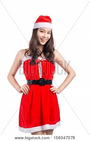 Christmas Woman. Beauty Asian Model Girl in Santa Costume isolated on White Background.