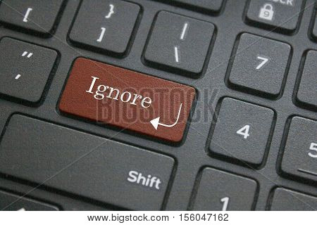Close up of ignore button on computer keyboard