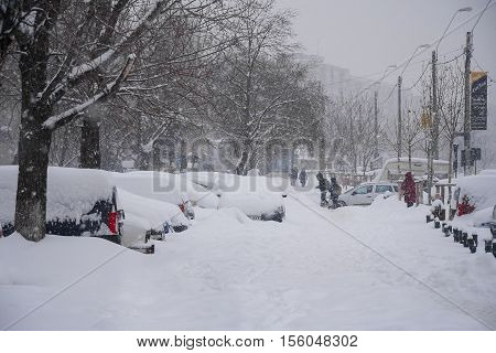 BUCHAREST - FEBRUARY 13 : Heavy snowfall of nearly 60 cm (2 feet) on February 13 2012 has paralyzed the traffic. People left their cars and are walking on the road in the snow.