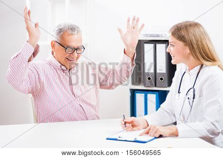 Happy patient is getting ecstatic when he heard the news of successful treatment.