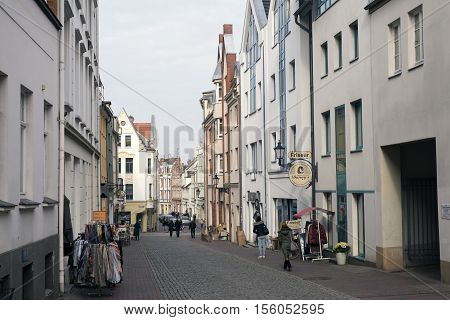 WISMAR GERMANY - OCTOBER 14 2016: People going sightseeing and shopping on October 14 2016 in Wismar famous Hanseatic city Germany.