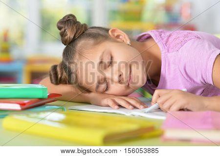 Cule girl fell asleep while she was doing her homework