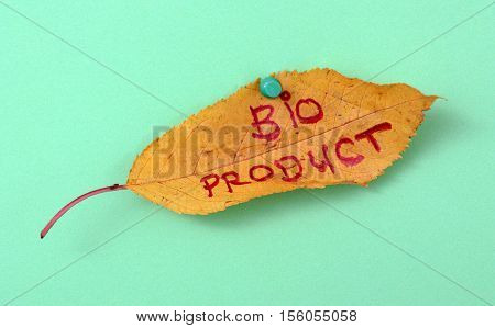 picture of a autumn walnut leaves with handwritten text bio product
