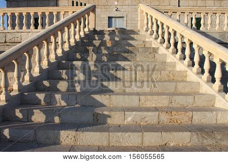 Perspective view of a marble staircase with handrails