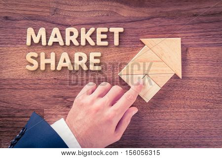 Increase market share for your company. Businessman plan (predict) market share growth represented by arrow.