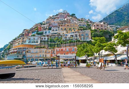 POSITANO ITALY - OCTOBER 5 2012: The colorful villas of the old town looks great from the central beach Marina Grande the best place to relax swim rent a boat or choose some cafe or restaurant on October 5 in Positano.