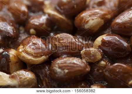 the whole almonds in caramel as background
