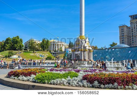 KIEV UKRAINE - SEPTEMBER 8 2016: Maidan Nezalezhnosti (Independence Square) with decorated with colorful flowerbeds and nice fountains on September 8 in Kiev.
